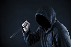 Hooded man with knife Stock Photos