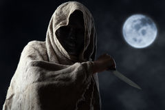 Hooded man in mask with knife Royalty Free Stock Photo