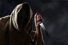 Hooded man in mask with a knife Royalty Free Stock Photos