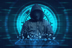 Hooded man with mask typing on keyboard virtual Stock Image