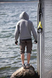 Hooded man before outdoor,suspension training at the sea Stock Photos