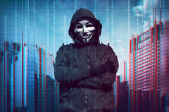 Hooded man wearing guy fawkes mask Royalty Free Stock Photography