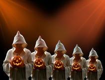 Hooded Men and Jack-0-Lantern Stock Photos