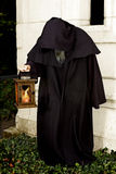 Hooded monk. Halloween scene of a hooded monk holding a lantern royalty free stock photography
