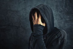 Hooded person fighting addiction crisis Royalty Free Stock Photos