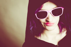 Hooded rebel girl. With fuchsia hair Stock Photography