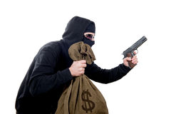 Hooded robber with a bag of money Stock Images