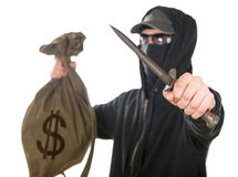 Hooded robber with a dagger Stock Photos