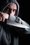 Hooded robber wielding a knife Royalty Free Stock Photo