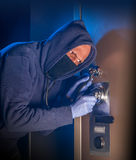 Hooded safe cracking thief Royalty Free Stock Images