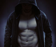 Hooded sportsman hidiing himself in the dark Royalty Free Stock Photography