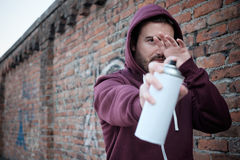 Hooded tagger hiding himself Royalty Free Stock Photos
