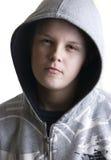 Hooded teenage boy stock image