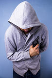 Hooded thug with gun Royalty Free Stock Photos