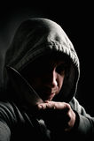Hooded thug holding a knife Royalty Free Stock Photo
