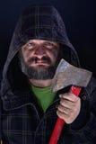 Hooded tough guy holding axe Stock Photos