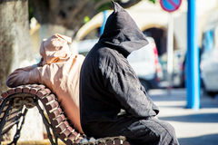 Hooded. Two men get rest in hoods Royalty Free Stock Image