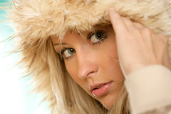 Hooded woman. Portrait of young beauty woman wearing hooded parka Stock Photo