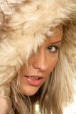 Hooded woman. Portrait of young beauty woman wearing hooded parka Stock Photography