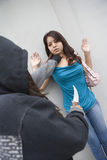 Hooded Woman Robbing Young Woman With Knife Stock Image