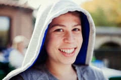 Hooden teenager with fifty years Stock Photos
