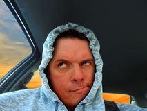 Hoodie confused driver. Photo of a hoodie driver with confused looking expression on face Royalty Free Stock Photography