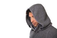 Hoodiestrickjacke Winter des jungen Mannes tragende Stockfotografie