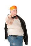 Hoodlum. Fat hoodlum with orange bandana pointing a pistol Stock Photography