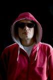 Hoodlum. A grim looking Hoodlum wearing sunglasses Royalty Free Stock Photos