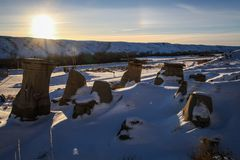 The hoodoos of drumheller during a sunny frosty winter day, drumheller, badlands of Alberta, Alberta, Canada. A hoodoo also called a tent rock, fairy chimney or stock images