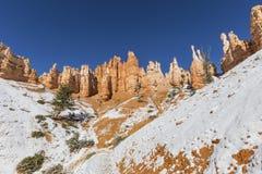 Hoodoo Towers and Snow at Bryce Canyon National Park royalty free stock photos