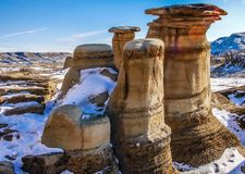 Hoodoos with a last blanket of snow. Hoodos, Willow Creek Trail, Cambria, Alberta,Hoodoos with a last blanket of snow, Drumheller, Alberta, canada Royalty Free Stock Image