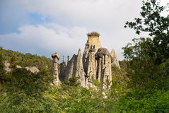 Hoodoos in Pontis, France. The Demoiselles Coiffées. A rock formation in Pontis, near Embrun in the French Alps. The formation consists of a number of hoodoos royalty free stock photo