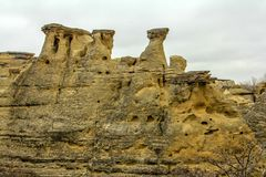Hoodoos reaching skyward in the badlands. Of Writing on Stone Provincial Park, Alberta, Canada Royalty Free Stock Photography
