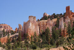 Hoodoos on the Road to Tropic. Red and pink rock formations known as hoodoos, line the road from Bryce Canyon to the small community of Tropic, Utah Stock Photo