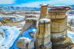 Hoodoos in the very early stages of spring. Some snow still on the ground, Drumheller, Alberta, Canada Royalty Free Stock Image