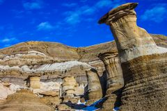 Hoodoos against a great blue sky. Hoodos, Willow Creek Trail, Cambria, Alberta,Hoodoos against a great blue sky, Drumheller, Alberta, Canada Royalty Free Stock Images