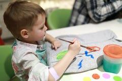 hoody儿童的绘画 库存照片