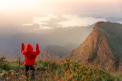 Hoody female traveler looking at mountain scenery stock photo