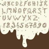Hoofd Engelse letters en getallen van gebakjeroom Stock Afbeeldingen