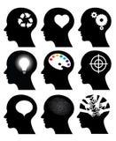Hoofd pictogrammen met ideesymbolen Stock Foto's