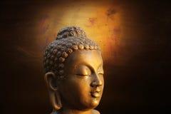 Hoofd van Budha op gouden achtergrond royalty-vrije stock afbeeldingen