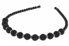 Hoofdband met groot zwart die parelsontwerp, op witte backgr wordt geïsoleerd Stock Foto's