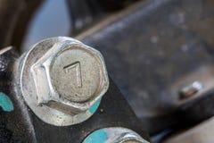 Hoofden van de close-up de zilveren Schroef nummer zeven royalty-vrije stock foto's