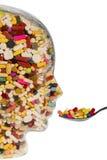 Hoofdglas met tabletten Stock Fotografie