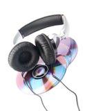 Hoofdtelefoon en compact-discs Stock Afbeeldingen