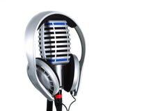 Hoofdtelefoon op microfoon Stock Foto's