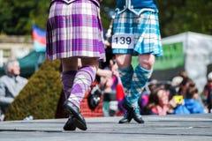 Hooglanddanser bij hooglandspelen in Schotland stock foto's
