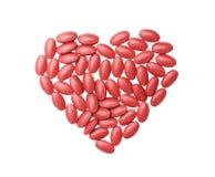 Hoogste het medicijntabletten en vitamine van het menings voedende bloed in hart gestalte gegeven patronen die op witte achtergro stock foto's