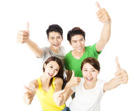 Hoogste mening van gelukkige jonge groep met omhoog duimen Stock Afbeeldingen